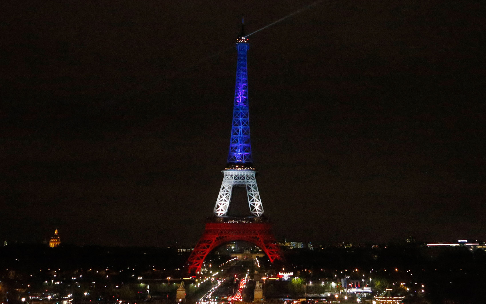 The Eiffel Tower is illuminated in the French national colors red, white and blue in honor of the victims of the terror attacks last Friday in Paris, Monday, Nov. 16, 2015. France is urging its European partners to move swiftly to boost intelligence sharing, fight arms trafficking and terror financing, and strengthen border security in the wake of the Paris attacks. (AP Photo/Frank Augstein)
